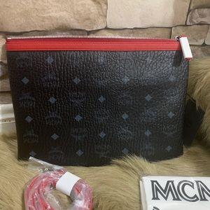 Authentic MCM logo Diamond Leather clutch/Crosby